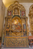 Seville - The side altar withe the st. Ann child Mary from year 1714 by Jose Montes de Oca in baroque Church of El Salvador. SEVILLE, SPAIN - OCTOBER 28, 2014 stock photo