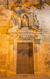 Seville - The side baroque portal of the church Iglesia de Santa Maria Magdalena with the statue of Santo Domingo de Guzman Royalty Free Stock Photo
