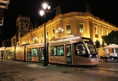 Seville spårvagn på natten royaltyfri bild