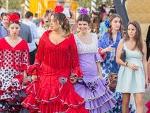 SEVILLE, SPAIN - APR, 25: women dressed in traditional costumes Stock Images