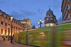 Modern tram passing through old town of Seville Spain stock photo