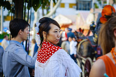 Seville, Spain - April 28, 2015: Japanese woman tourist dressed Royalty Free Stock Image