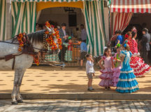 Young girls in flamenco style dress at the Seville's April Fair Stock Photography