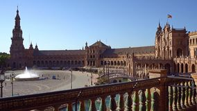 Seville, plaza de epana. Seville, Spain-august 7,2017: tourists stroll and admire the famous plaza de Espana in Seville during a sunny day stock video footage