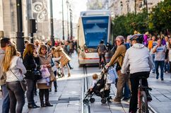 SEVILLE, SPAIN. DECEMBER 2015. Some people walking during the da stock photography