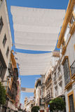 Seville (Spain - Europe). Awnings on the Seville street (Spain - Europe Royalty Free Stock Photography