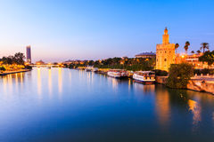Seville, Spain. Guadalquivir river and Golden Tower Torre del Oro stock photo