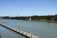 Rowing canal for water sports on the Guadalquivir river in Seville. SEVILLE, SPAIN - JULY 17, 2011: Rowing canal for water sports on the Guadalquivir river in royalty free stock image