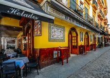 Facade of traditional colourful tapas bar in the historic centre of Seville stock photo