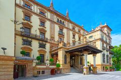 Hotel Alfonso XIII remains an iconic cultural landmark in Sevill. Seville, Spain - June 09, 2017:Commissioned by the King of Spain to play host to international Royalty Free Stock Photo