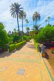 Gardens of Royal Alcazar in Seville and Grotto Gallery  Galeria. Seville, Spain - June 09, 2017 : View of big and beautiful garden - Gardens of Royal Alcazar in Stock Image