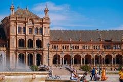 People enjoy sightseeing at the Plaza de España. Seville, Spain. royalty free stock photos