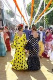 People taking a walk and dressed in traditional costumes at the Seville`s April Fair. Seville, Spain - May 03, 2017: People taking a walk and dressed in royalty free stock image