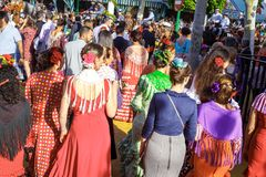 People taking a walk and enjoying at the Seville`s April Fair. Seville, Spain - May 03, 2017: People taking a walk and enjoying at the Seville`s April Fair royalty free stock images