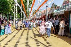 People taking a walk and enjoying at the Seville`s April Fair. Seville, Spain - May 03, 2017: People taking a walk and enjoying at the Seville`s April Fair royalty free stock photography