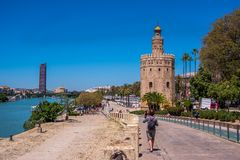 Seville Spain May 8th 2019 Golden tower Torre del Oro along the Guadalquivir river, Seville Spain. Seville Spain May 8th 2019 Golden tower Torre del Oro along stock photography