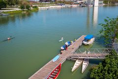 SEVILLE, SPAIN May 8th 2019 Rowers along the Guadalquivir river, Seville, Seville Province, Andalusia, Spain, Europe. SEVILLE, SPAIN May 8th 2019 Rowers along royalty free stock photos