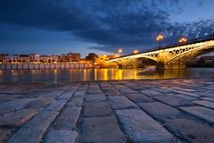 Sevilla in Spain, Night view of the fashionable and historic districts of Triana. Seville, Spain, Night view of the fashionable and historic districts of Triana royalty free stock photography