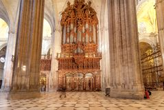Marble columns inside the 16th century Sevilla Cathedral with golden decoration and reliefs stock photos