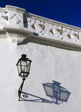 Seville, Spain. Whitewash facade and shadow in late afternoon sunlight. Royalty Free Stock Photography