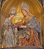Seville - The st. Ann and child Mary from year 1714 by Jose Montes de Oca on side alta of baroque Church of El Salvador Stock Image