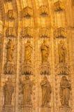 Seville - The statues of holys on the main west portal (Puerta de la Asuncion) of Cathedral de Santa Maria de la Sede Royalty Free Stock Photography