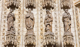 Seville - The statues of holys on the main west portal (Puerta de la Asuncion) of Cathedral de Santa Maria de la Sede Royalty Free Stock Image