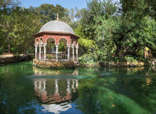Seville - The summer house Maria Luisa park. And the garden lake Stock Image