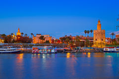 Seville sunset skyline torre del Oro and Giralda stock photography