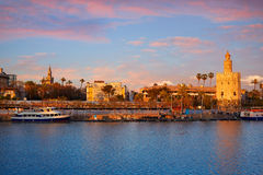 Seville sunset skyline torre del Oro and Giralda stock images