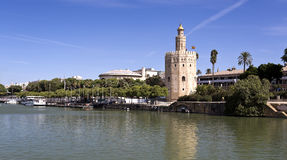 Seville Torre del Oro. The Torre del Oro (Tower of the Gold), a dodecagonal military watchtower, seen from the Guadalquivir River in Seville, Spain royalty free stock photo