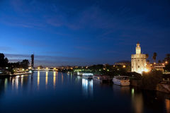 Seville, Tower of the Gold together with the guadalquivir. I laugh guadalquivir to his step along the city of Seville stock photography