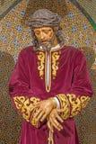 Seville - The tradicional vested Jesus Christ statue in bond in church Iglesia de San Pedro. Royalty Free Stock Photos