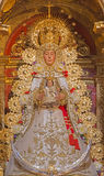 Seville - The tradicional vested Madonna statue (Virgen del Rocijo)  in baroque Church of El Salvador (Iglesia del Salvador) Royalty Free Stock Photo