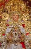 Seville - tradicional vested Madonna statue (Virgen del Rocijo) by S. S. Rojas from side altar in baroque Church of El Salvador Stock Photography