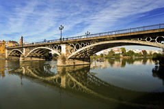 Seville Triana Bridge. View of the Triana Bridge (official name is Bridge of Isabel II) over the Guadalquivir River in Seville, Spain stock photos