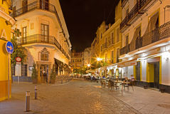 Seville - The typically street at night. Royalty Free Stock Photos