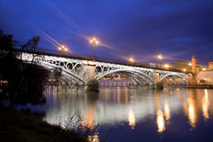 Sevillie, panorama of the old Triana Bridge. Royalty Free Stock Images