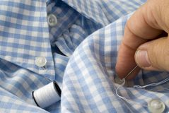Sew on a button Stock Photos