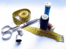 Sew objects. Measure, cotton treath, scissors and thimble Stock Image