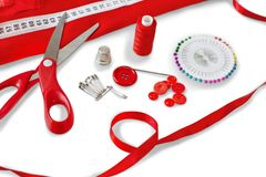 Various red color Sewing supplies isolated on royalty free stock image