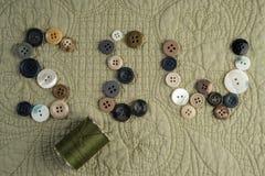 SEW stavade ut med knappar, med tråden Royaltyfri Foto