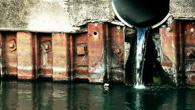 Sewage discharged into the river Stock Photos