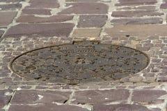 Sewage drain hatch Royalty Free Stock Photo
