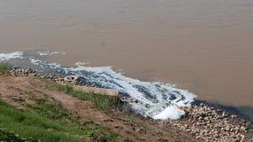 Sewage drains unthreated polluted waters into the Mekong River, Thailand, South East Asia.  stock video