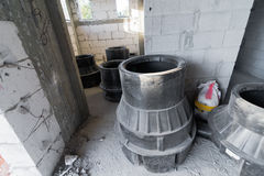 Sewage equipment Inside a brick and concrete house under constru Stock Images