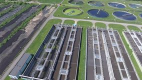 Sewage farm. Static aerial photo looking down onto the clarifying tanks and green grass. stock video footage