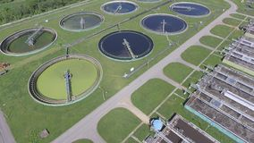 Sewage farm. Static aerial photo looking down onto the clarifying tanks and green grass. stock footage