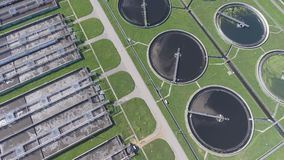 Sewage farm. Static aerial photo looking down onto the clarifying tanks and green grass. stock video