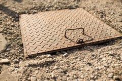 Sewage iron cover close up shot near residentual house royalty free stock photos